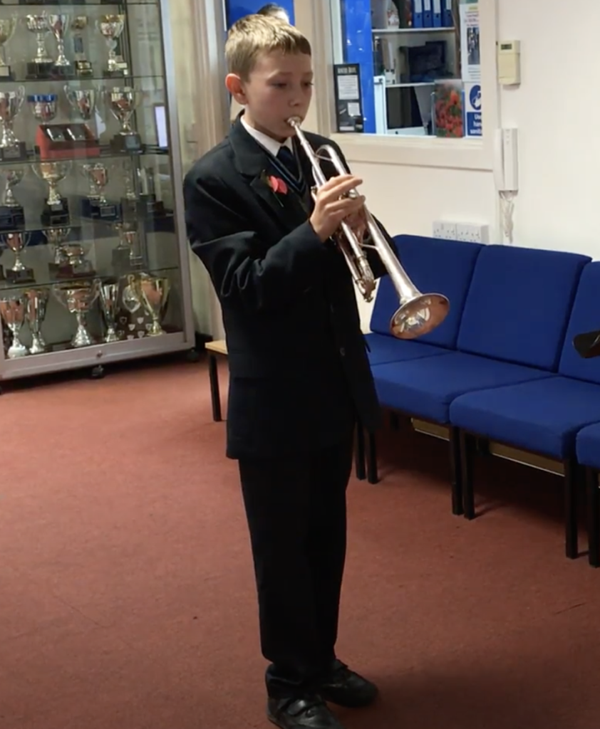 Pupil playing The Last Post